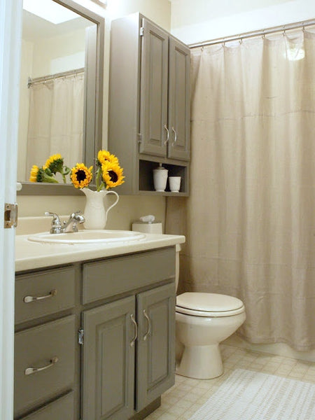 small gray bathroom with shower curtain, sunflowers, dark gray cabinets... Small Bathroom Ideas: Shower Spaces from Bathroom Bliss by Rotator Rod