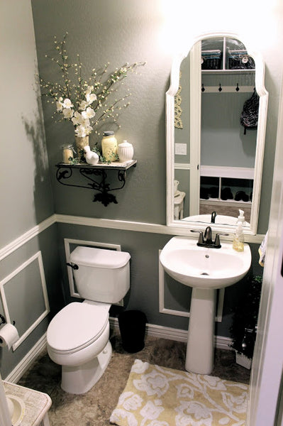 gray bathroom with white accents, large white framed mirror, pedestal sink and decorative shelf... Small Bathroom Ideas: Trendy Bathroom Mirror Updates from Bathroom Bliss by Rotator Rod