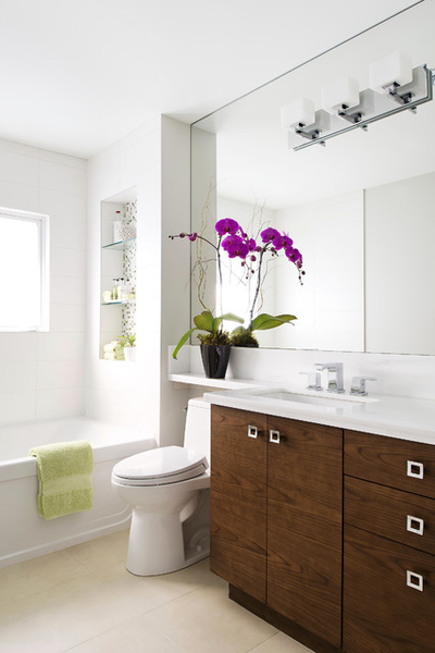 white bathroom with wood accents, purple orchid flowers, and oversized mirror... Small Bathroom Ideas: Trendy Bathroom Mirror Updates from Bathroom Bliss by Rotator Rod