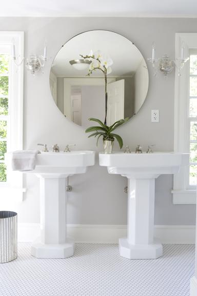 white master bathroom with twin pedestal sinks, round mirrors, and orchid flowers... Small Bathroom Ideas: Trendy Bathroom Mirror Updates from Bathroom Bliss by Rotator Rod