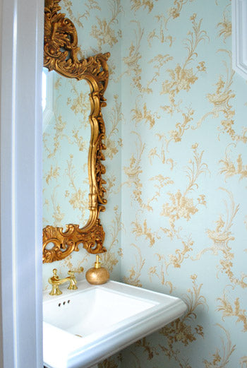 Beautiful Small Light Blue And Gold Bathroom With Gold Ornate Mirror,  Delicate Wallpaper.