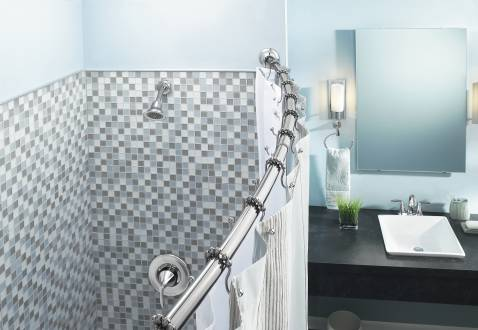 serene light blue bathroom with a curved shower rod... Straight Vs. Curved Shower Rods from Bathroom Bliss by Rotator Rod