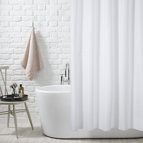 modern bathroom with white painted brick, freestanding bathtub, and white shower curtain... Trending in Bathroom Decor: Airy, White Shower Curtains from Bathroom Bliss by Rotator Rod