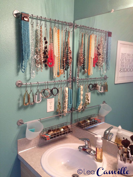gorgeous jewelry bathroom wall display created out of repurposed Ikea items... Trending in Bathroom Decor: Stylish Jewelry Stands from Bathroom Bliss by Rotator Rod
