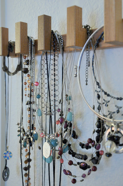 gorgeous jewelry wall display created out of repurposed Ikea items... Trending in Bathroom Decor: Stylish Jewelry Stands from Bathroom Bliss by Rotator Rod