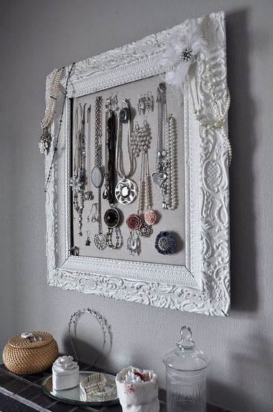 elegant and feminine white frame bathroom jewelry holder... Trending in Bathroom Decor: Stylish Jewelry Stands from Bathroom Bliss by Rotator Rod
