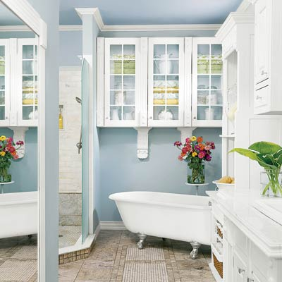 tranquil & spa-inspired light blue bathroom with white accents, flowers & freestanding bathtub... Trending in Bathroom Design: Blue Bathrooms from Bathroom Bliss by Rotator Rod