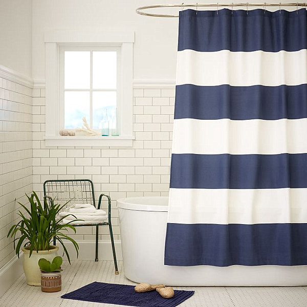 nautical bathroom with blue & white striped shower curtain... Trending in Bathroom Design: Blue Bathrooms from Bathroom Bliss by Rotator Rod