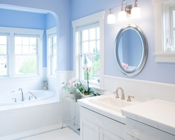 luxurious & feminine blue bathroom with white & silver accents & orchid flowers... Trending in Bathroom Design: Blue Bathrooms from Bathroom Bliss by Rotator Rod