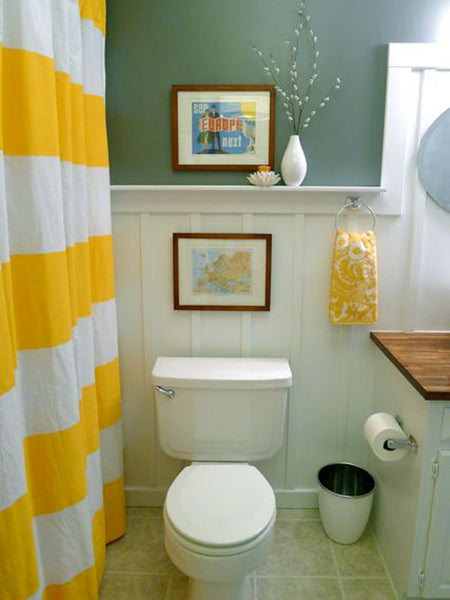 fun white and green bathroom with yellow accents and travel accessories trending in