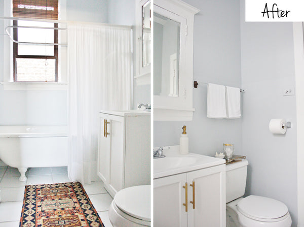 clean white bathroom with oriental rug, white shower curtain, white and gold accents... Trending in Home Decor: Winter Bathroom Inspiration from Bathroom Bliss by Rotator Rod