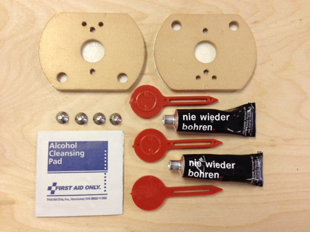 No Drill Adapter Kit for mounting on tile and stone.  Copper composite mounting disks, cleansing pads, adhesive tubes with  keys for easy dispensing
