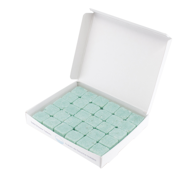Open rectangular container with 5x6 rows of blue, body wash tablets