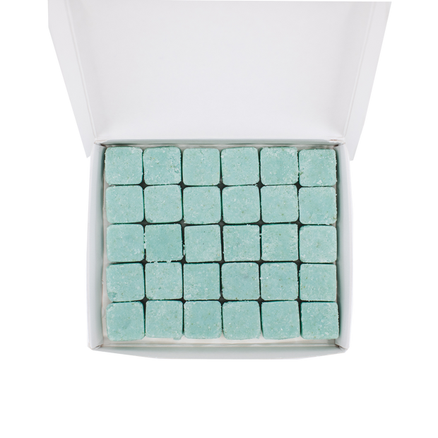 Overhead shot of open rectangular container with 5x6 rows of blue. body wash tablets