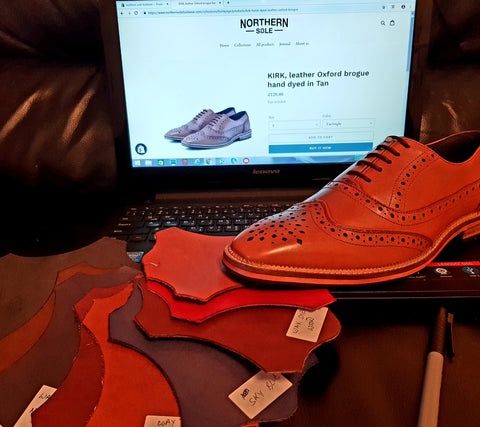 Men's leather brogue shoe, choosing colours to offer as options for hand dying. Northern sole website creation via lap top, showing men's leather brogue in product pages.