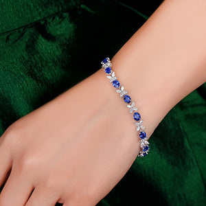 6.97ctw Natural Blue Sapphire and Marquise Diamond 18kt AU750 White Gold Bracelet
