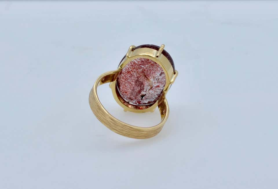 Strawberry Quartz 'Super Seven' Oval Set in 14 Carat Gold Ring