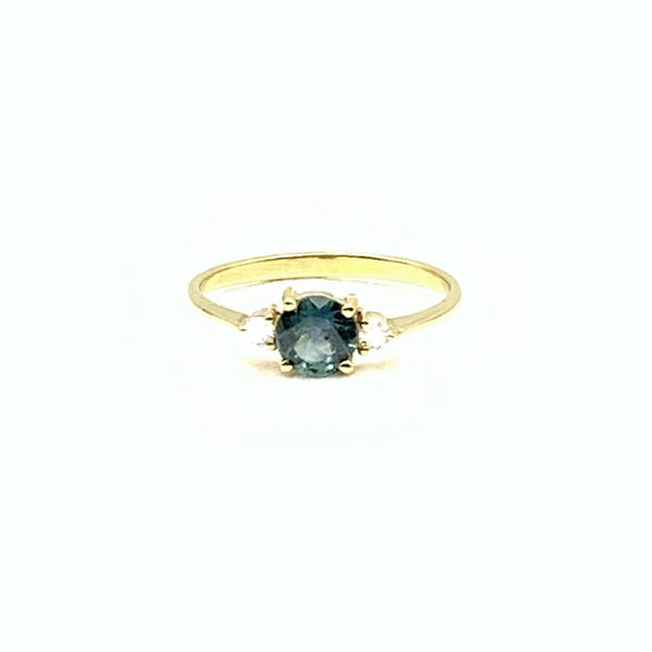 14 Karat Yellow Gold Ring with Teal Blue Montana Sapphire 0.63 Carat Center stone With Two Diamonds on Either Sides