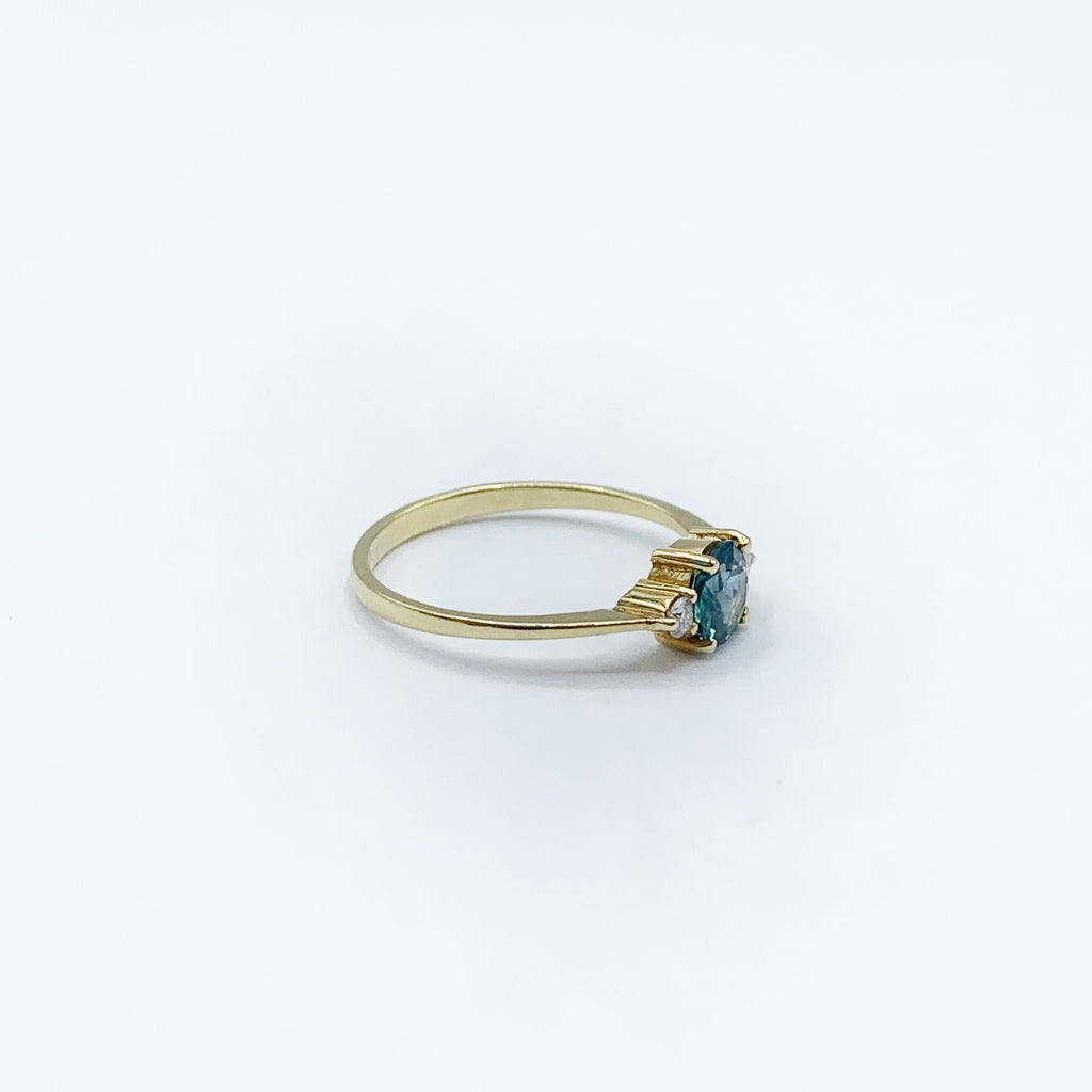 14 Karat Yellow Gold Ring with Round Montana Sapphire