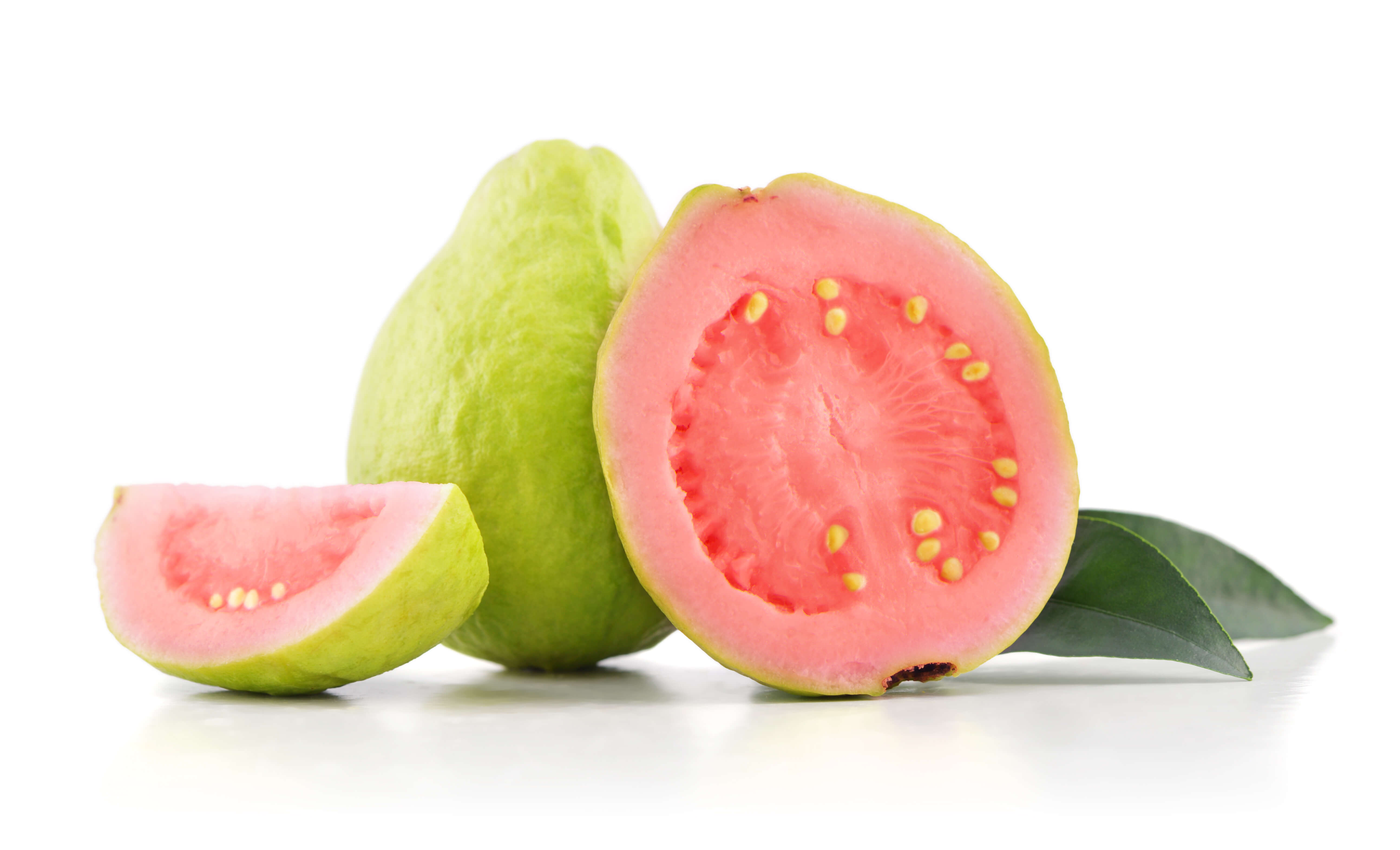 Whole and cut pink guava fruits
