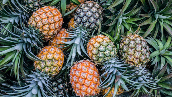 A pile of fresh tropical pineapples