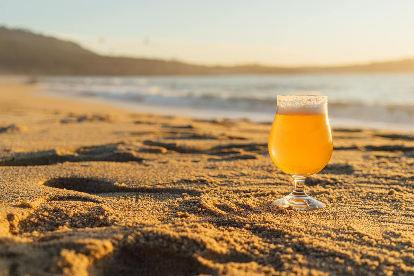 A glass of fruit beer on the beach