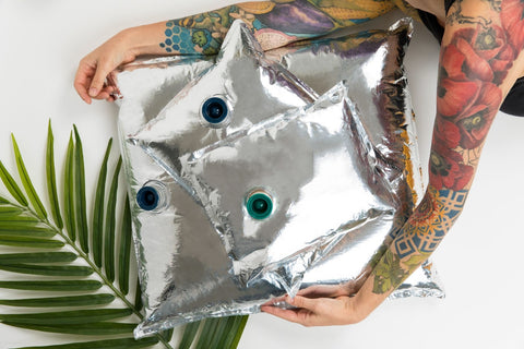 Person holding silver aseptic packaging