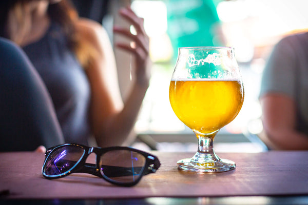 Summer fruit beer and sunglasses