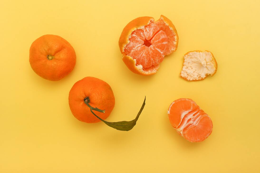 Tangerines on a yellow background