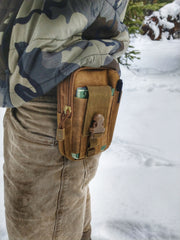 Tech Pouch attached to belt for conveniently carrying hunting accessories while not being bulky or cumbersome.