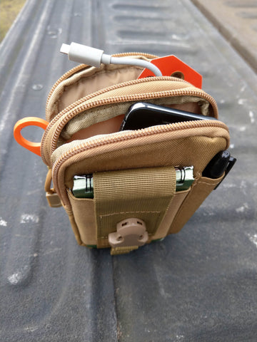 Tech pouch packed full of gadgets for hunting.