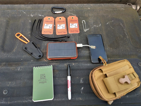 Hunt-Tag Tech Pouch setup for hunting with gear, tag kit, and phone. Keep hunting tags dry and safe.