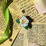 Black Antique White Rose pin on leaflet background