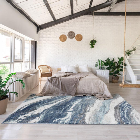 Luxe weavers contemporary rug in a bedroom