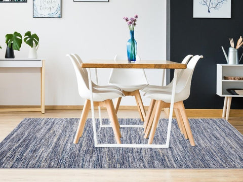 Two chairs on dining area rug