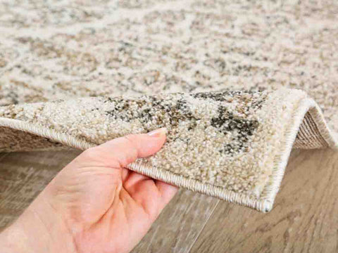 Man touching luxe weavers victoria collection oriental area rug