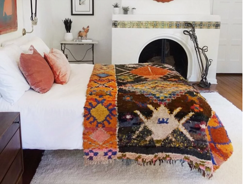 bed with rug and bedspread