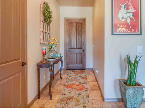 colorful entryway rug in an entrance hall