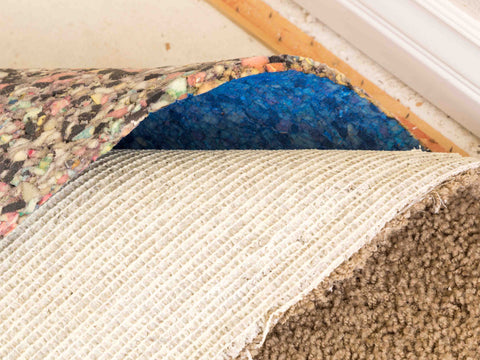 An Area rug pad at the corner of a room
