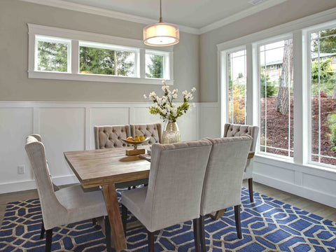 Transitional rug below a dinning room furniture set