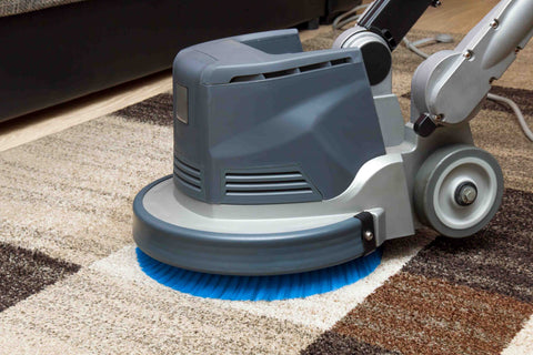 Vacuuming an area rug before moving it