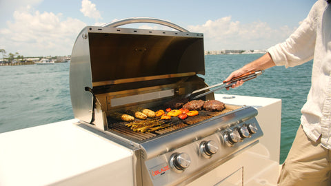 Man cooking meat and vegetables on his Blaze LTE Marine Grade Grill