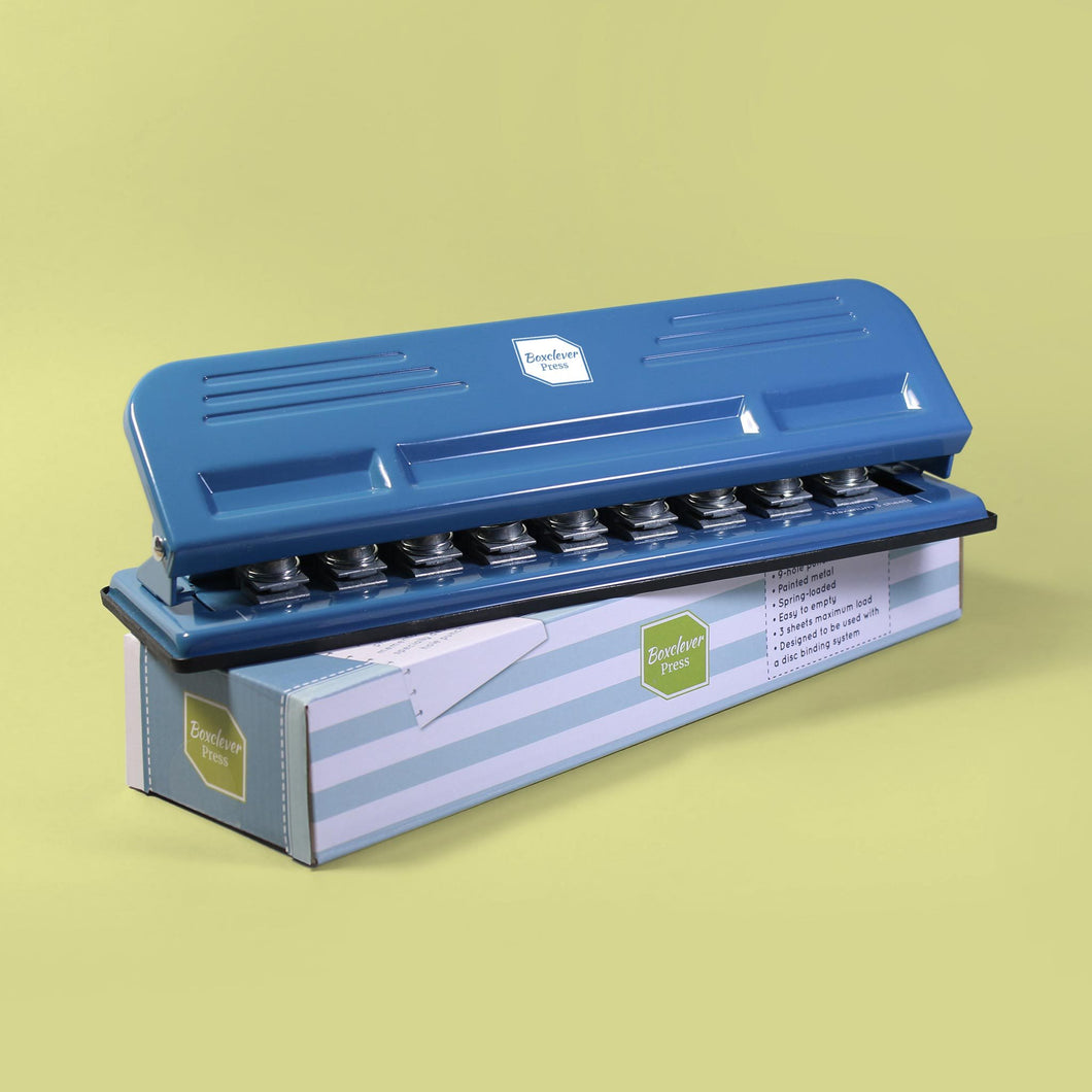 Busy_Days Punch_Category Busy Days creative planner special hole punch in blue sat on its box on a green background