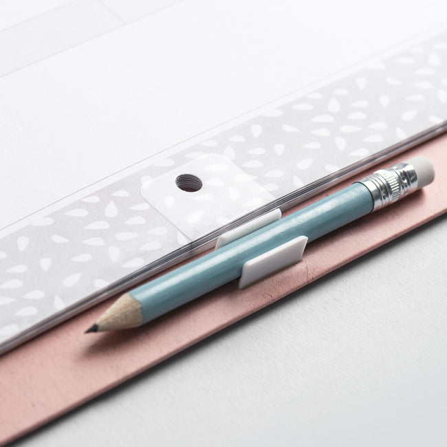 Close up of the hanging hole and pale blue pencil on the mint green and pink watercolour design Family Home Planner wall calendar 2020