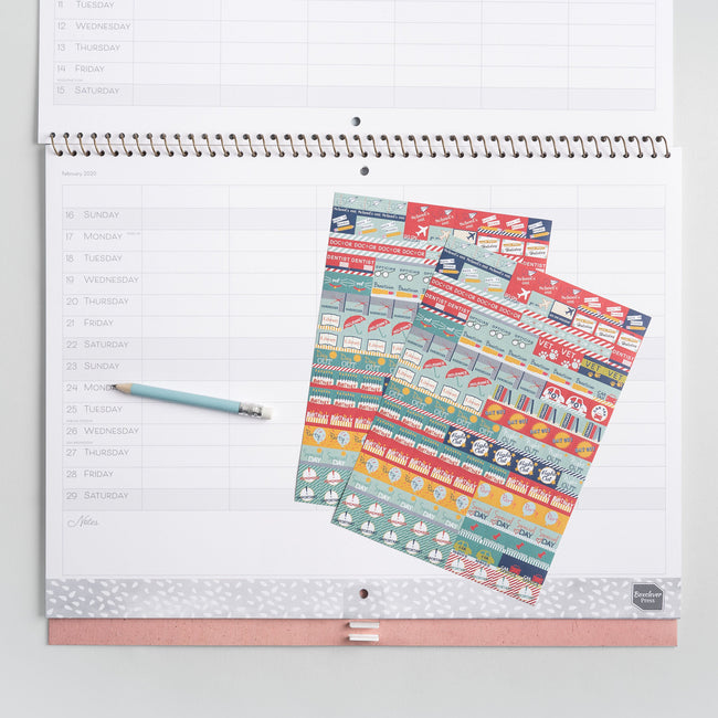 The Family Home Planner 2020 month to view calendar monthly page with colourful stickers displayed on a pale grey wall