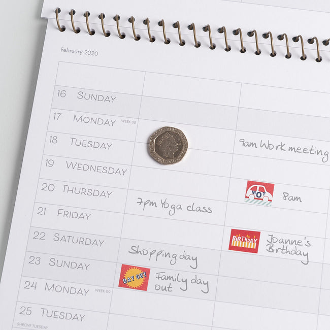 The 2020 calendar Family Home Planner month to view page featuring a UK twenty pence for size comparison