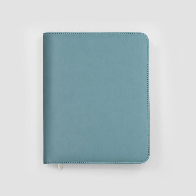 Closed A5 diary cover with rounded corners and silver zip on grey background