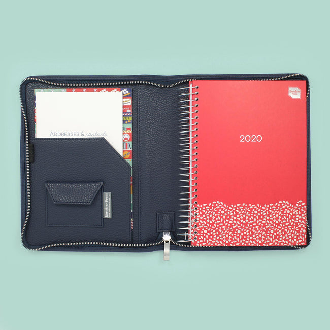 A5 Family Life Book diary with a red cover and silver floral detail sat in a Midnight Blue diary cover.