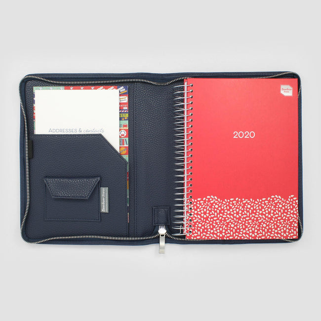 Family Life Book diary with a red cover and silver floral detail sat in a Midnight Blue diary cover.