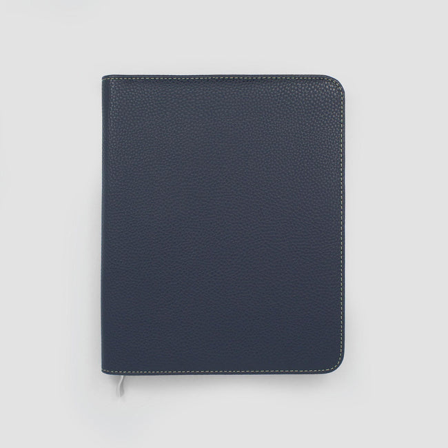 Dark blue diary cover with rounded corners and silver zip